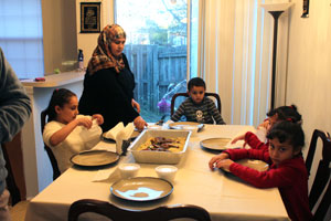 111215-refugees-Family-at-dinner-table